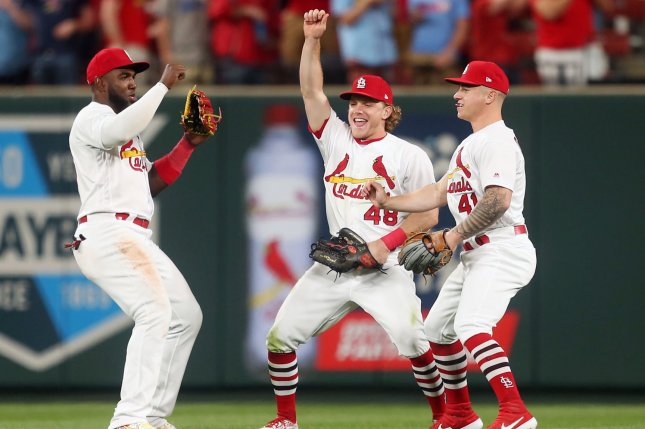 Marcell Ozuna's (L) fellow St. Louis Cardinals outfielders had a laugh at his expense after his eighth inning fall during a win against the Los Angeles Dodgers Tuesday in St. Louis. Photo by Bill Greenblatt/UPI