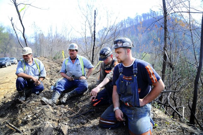Massey Energy workers Maurice Blanchette (L), Jimmy Shortridge (2nd-L), Brandon Waddell (2nd-R) and Andrew Lucas take a break from drilling efforts above Massey Energy's Upper Big Branch Coal Mine on April 7, 2010, in Montcoal, W.Va. On April 5, 2010, an explosion in a coal mine near Montcoal, in West Virginia's Raleigh County, killed 29 workers. File Photo by Jeff Gentner/UPI