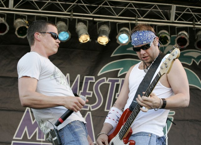 Todd Harrell (R) and Brad Arnold with 3 Doors Down perform in concert prior to the running of the IRL Gainsco Indy 300 at Homestead-Miami Speedway in Homestead, Florida on March 29, 2008. (UPI Photo/Michael Bush)