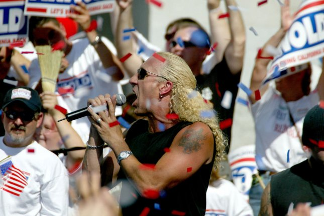 Twisted Sister' lead singer Dee Snider sings 'We're Not Gonna Take It Anymore', during a rally on the south steps of the State Capitol,for Republican Arnold Schwarzenegger Candidate For California Governor, in Sacramento, California October 5th, 2003. The rally ended a 4 day state wide bus trip. Schwarzenegger is running for Governor in the October 7 Recall Election. ..(UPI/Ken James)