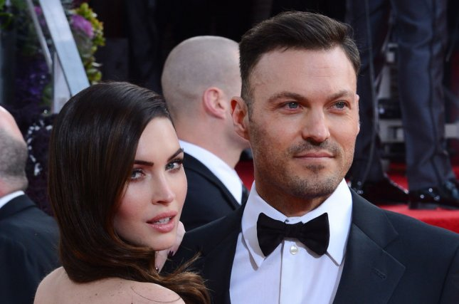 Brian Austin Green (R) and Megan Fox attend the Golden Globe Awards on January 13, 2013. The actor confessed Wednesday on his podcast that his relationship with Fox takes hard work. File Photo by Jim Ruymen/UPI