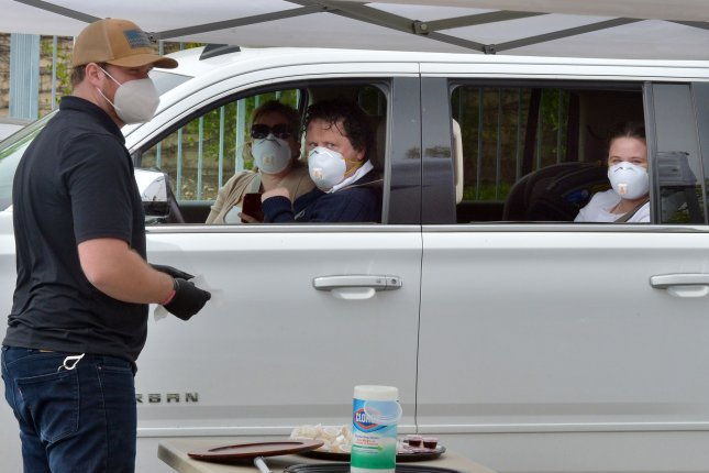 Parishioners use a drive-through on April5 to partake in the sacrament of communion at the Godspeak Calvary Chapel in Thousand Oaks, Calif. File Photo by Jim Ruymen/UPI