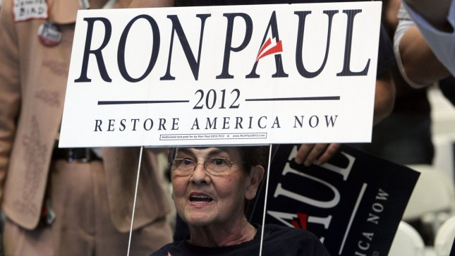 Supporter Eileen Halasey of Crestwood, Missouri cheers on Republican Presidential candidate Ron Paul in St. Charles, Missouri on March 10, 2012. As of Monday, Ron Paul has suspended campaign activities. UPI/Bill Greenblatt