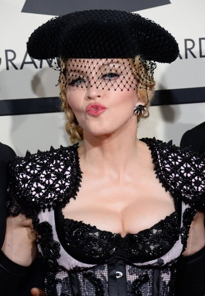Madonna planted her lips on Drake during his Coachella performance and now says she regrets it. File photo by Jim Ruymen/UPI
