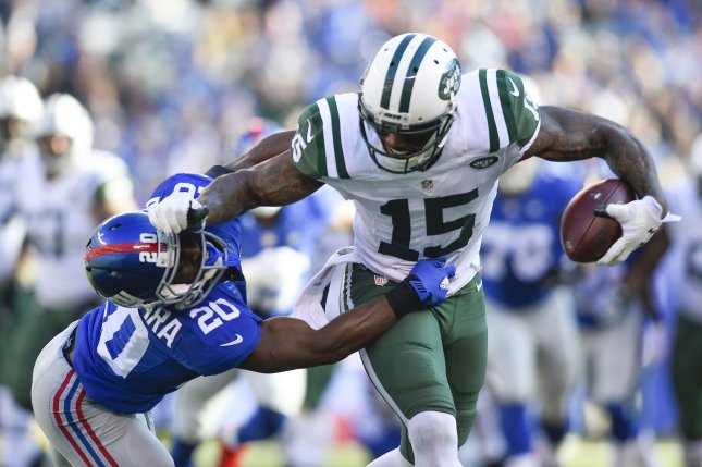 New York Jets wide receiver Brandon Marshall (15) stiff arms New York Giants cornerback Prince Amukamara (20) after a 20 yard reception in the 2nd quarter at MetLife Stadium in East Rutherford, New Jersey on December 6, 2015. Photo by Rich Kane/UPI