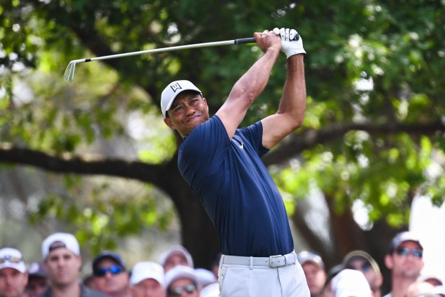 Tiger Woods watches his shot on the 4th tee during the first round of the Masters Tournament on Thursday at Augusta National Golf Club in Augusta, Georgia. Photo by Kevin Dietsch/UPI