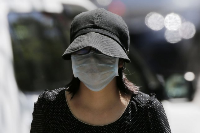 Several major U.S. retailers, including Walmart and Walgreens, will not allow shoppers into stores without a facial mask or covering, beginning Monday. File Photo by John Angelillo/UPI