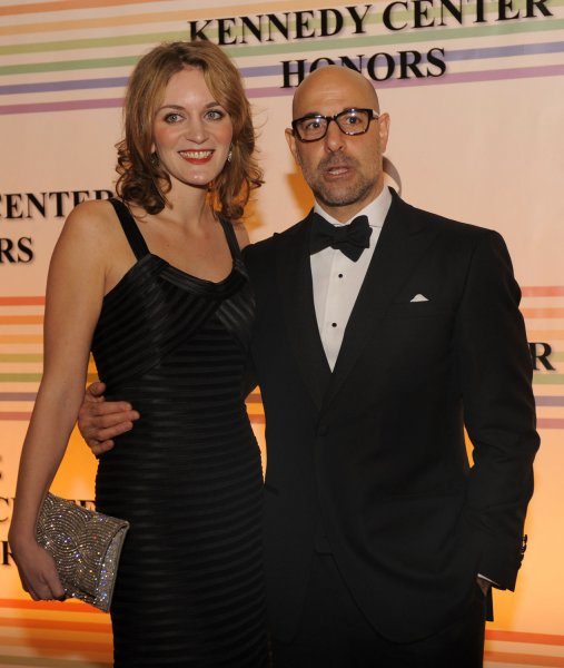 Actor Stanley Tucci and his fiance Felicity Blunt pose for photographers on the red carpet as they arrive at the Kennedy Center for the Performing Arts for a gala evening for the 2011 Kennedy Center Honorees, December 4, 2011, in Washington. The Kennedy Center annually salutes a select group for their contributions to the performance arts in America. UPI/Mike Theiler