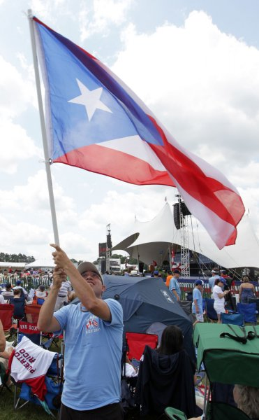 William Bizarro of Puerto Rico waves his country's flag before a baseball game. The Supreme court will not review a court case that challenges Puerto Rican voting regulations. UPI/Bill Greenblatt