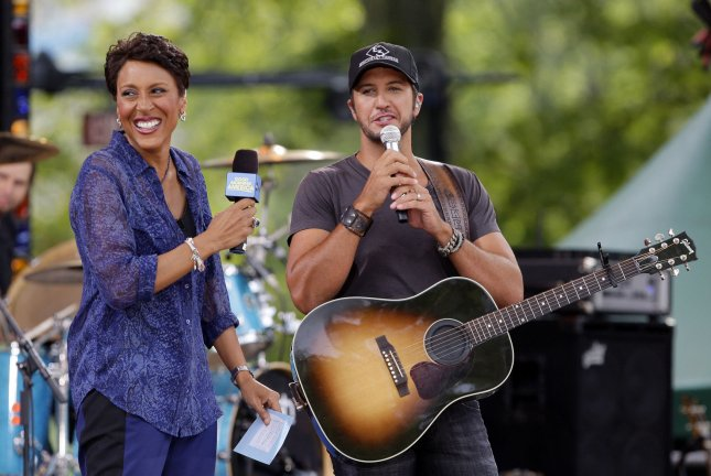 Robin Roberts interviews Luke Bryan on stage when he performs on the Good Morning America Show at the Rumsey Playfield/SummerStage in Central Park in New York City on JuLY 13, 2012. UPI/John Angelillo
