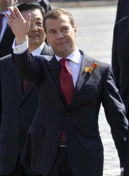 Russian President Dmitry Medvedev waves next to Chinese President Hu Jintao during the Victory Day military parade marking the 65th anniversary of victory over Nazi Germany on Red Square in Moscow May 9, 2010. UPI