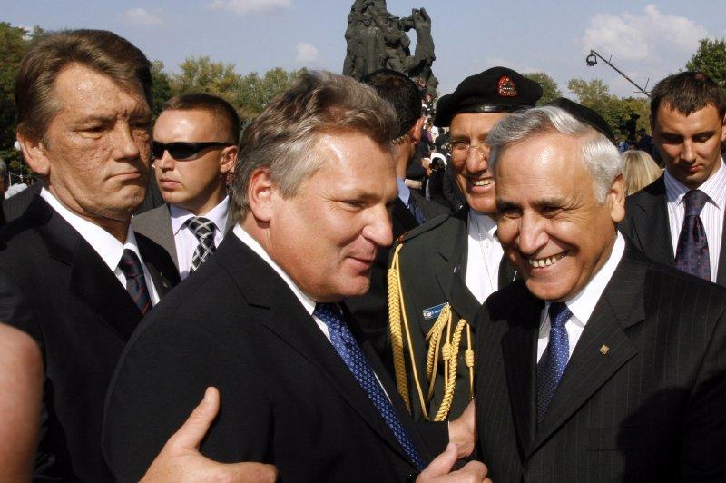 Former Polish President Alexander Kwasniewski (C) in 2006. File Photo by UPI Photo/Sergey Starostenko.
