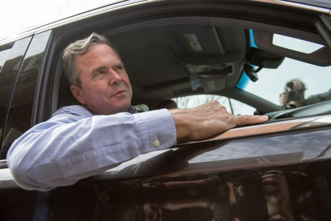 Republican Presidential hopeful Jeb Bush is seen in his car during a visit to a polling location on primary election day in Daniel Island, South Carolina on February 20, 2016. Photo by Kevin Dietsch/UPI