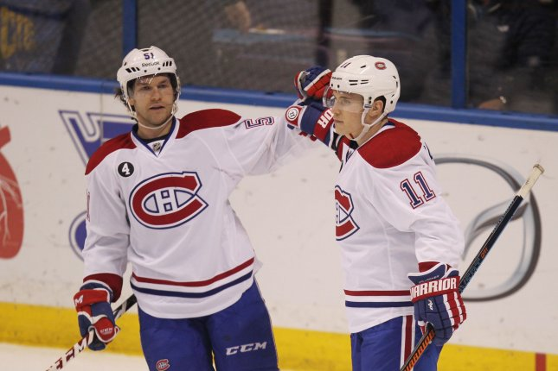 Former Montreal Canadien David Desharnais (51) congratulates Brendan Gallagher. File photo by Bill Greenblatt/UPI