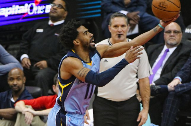 Memphis Grizzlies guard Mike Conley (11) scores on the layup. File photo by Mark Goldman/UPI