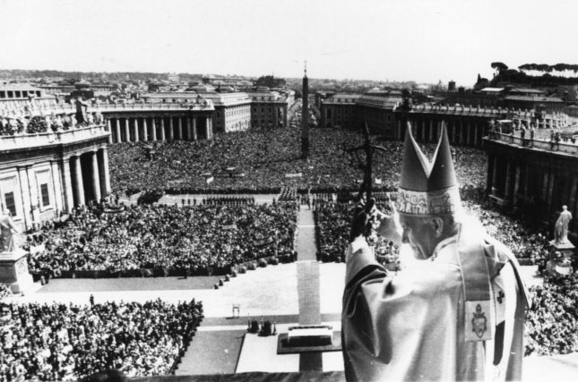 Pope John Paul II waves to more than 300,000 people from the central Loggia of St. Peter's Basilica following Easter services on April 19, 1981. Less than a month later, Turkish gunman Mehmet Ali Agca shot and injured the pope in St. Peter's Square. UPI File Photo