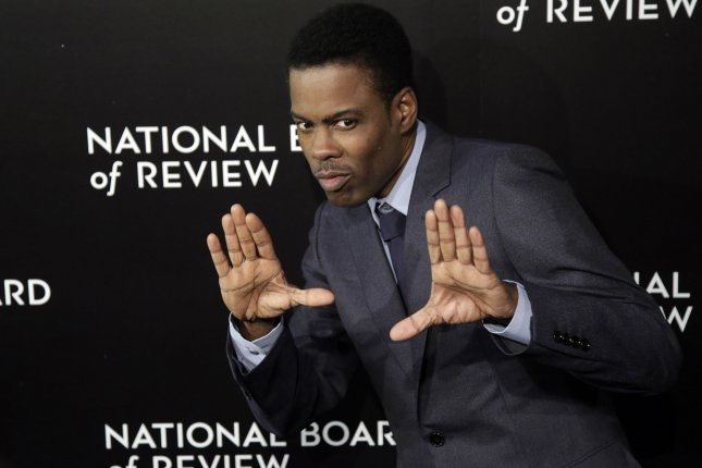 Chris Rock arrives on the red carpet at the 2014 National Board of Review Gala on January 6, 2015. Rock along with fellow comedians including Ellen DeGeneres star in a new Netflix ad to promote a slate of upcoming comedy specials. File Photo by John Angelillo/UPI