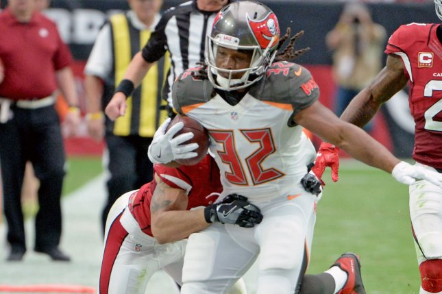 Tampa Bay Buccaneers' running back Jacquizz Rogers (32) gets knocked out of bounds in a Buccaneers-Cardinals game in 2016 at University of Phoenix Stadium in Glendale, Ariz. File photo by Art Foxall/UPI