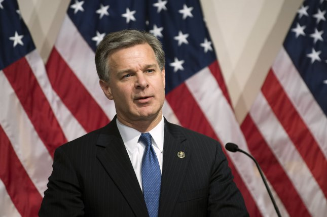 FBI director Christopher Wray talks Thursday about the indictment of two Chinese nationals accused of hacking. Photo by Kevin Dietsch/UPI