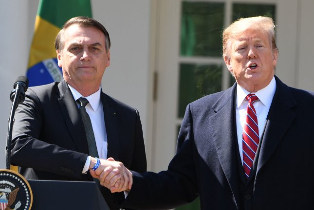 President Donald Trump shakes hands with Brazilian President Jair Bolsonaro. Trump officially declared Brazil a major U.S. ally Wednesday. Photo by Pat Benic/UPI
