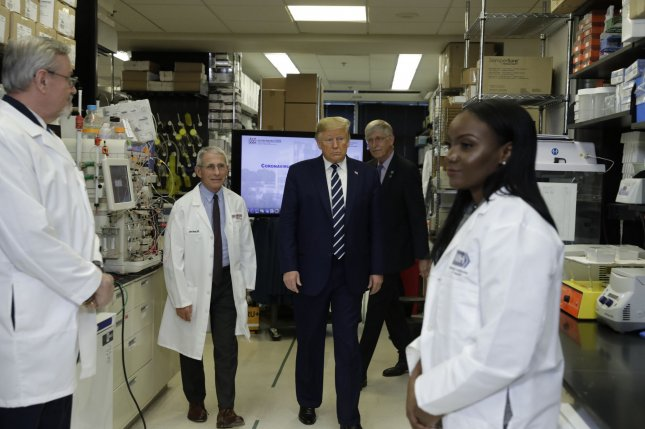 President Donald Trump tours the Viral Pathogenesis Laboratory at the National Institutes of Health on Tuesday in Bethesda, Md. Photo by Yuri Gripas/UPI