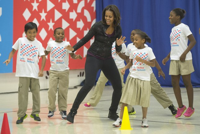 Today's kids run a mile minute-and-a-half slower than their parents. First Lady Michelle Obama exercises with students from Orr Elementary School. UPI/Kevin Dietsch