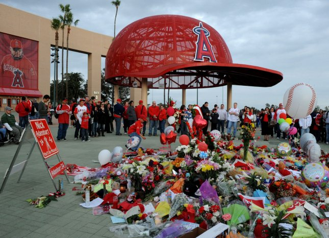 Los Angeles Angels fans gather around a temporary memorial for Los Angeles Angels rookie pitcher Nick Adenhart before the Angels' game against the Boston Red Sox in Anaheim, California on April 10, 2009. Adenhart and two other people were killed early Thursday in an auto accident in Fullerton, California just hours after Adenhart pitched in his season debut. (UPI Photo/Jim Ruymen)