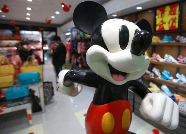 An unauthorized Disney store sells Disney clothing, dolls and other trademarked items in a mall in Beijing on April 19, 2013. Despite China's promises to enforce intellectual property rights (IPR) across the country, Chinese businesses have copied entire stores and goods, such as Disney, Nike, Apple, McDonald's, Starbucks, IKEA and many more due to loose copyright laws. UPI/Stephen shaver