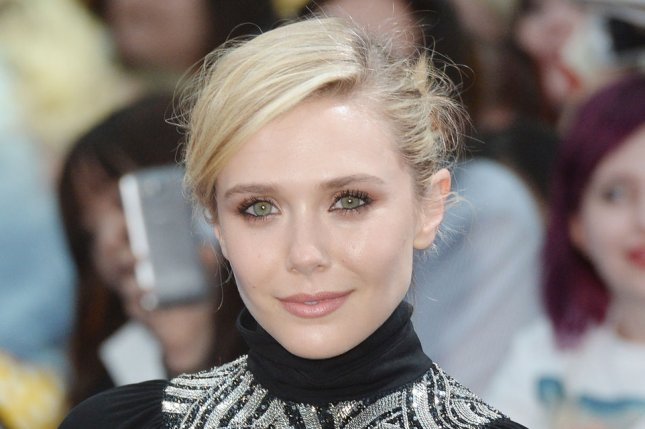 Elizabeth Olsen at the London premiere of 'Avengers: Age of Ultron' on February 21, 2015. The actress had a Marilyn Monroe moment at the Miu Miu show at Paris Haute Couture Week on Saturday. File photo by Rune Hellestad/UPI