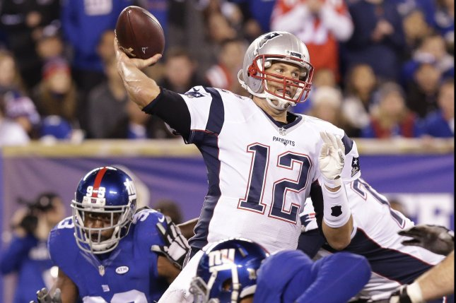 New England Patriots Tom Brady throws a pass against the New York Giants at MetLife Stadium in East Rutherford, New Jersey on November 15, 2015. The Patriots defeated the Giants 27-26. Photo by John Angelillo/UPI