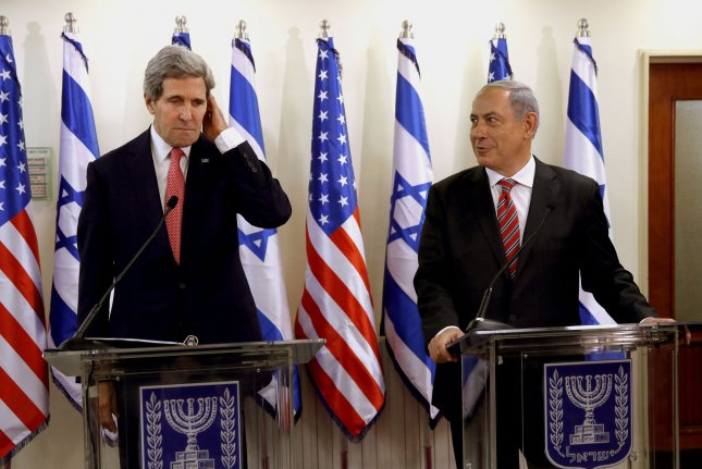 U.S. Secretary of State John Kerry (L) appears with Israeli Prime Minister Benjamin Netanyahu during a news conference after a meeting at Netanyahu's Jerusalem office on December 5, 2013. They are expected to meet again next week at an undetermiend location in Israel. Photo by Gali Tibbon/UPI/Pool