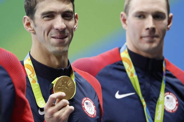 Michael Phelps of the United States holds his gold medal after the Men's 4 x 100m Medley Relay Final at the Olympic Aquatics Stadium at the 2016 Rio Summer Olympics in Rio de Janeiro, Brazil, on August 13, 2016. Michael Phelps wins his 23rd all time Olympic gold medal. Photo by Matthew Healey/UPI