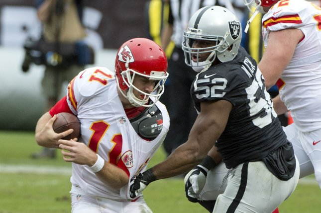 Kansas City Chiefs QB Alex Smith (11) is sacked by Oakland Raiders' Khalil Mack (52) in the second quarter at O.co Coliseum in Oakland, California on December 6, 2015. The Chiefs defeated the Raiders 34-20. Photo by Terry Schmitt/UPI