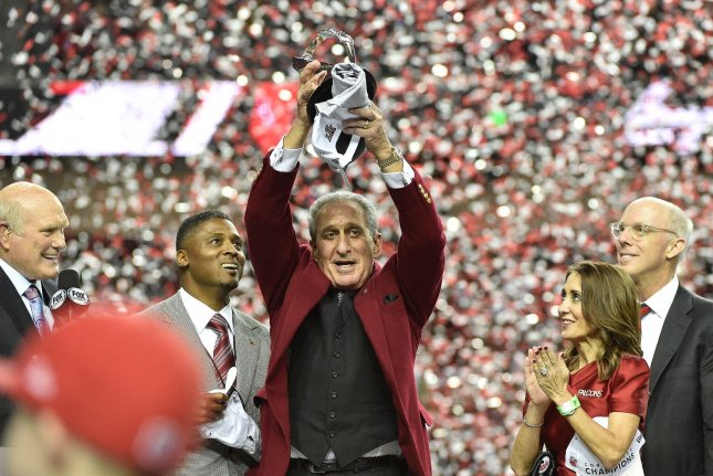 Atlanta Falcons owner Arthur Blank (C) celebrates with the George Halas trophy after defeating the Green Bay Packers 44-21 to win the NFC Championship game at the Georgia Dome on January 22, 2017 in Atlanta. Photo by David Tulis/UPI