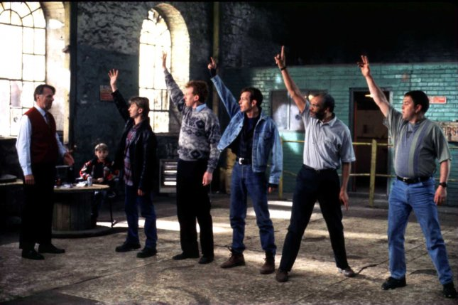 Cast members in a scene from The Full Monty, which was nominated for the Best Picture Oscar in 1998. File Photo by Jim Ruymen/UPI