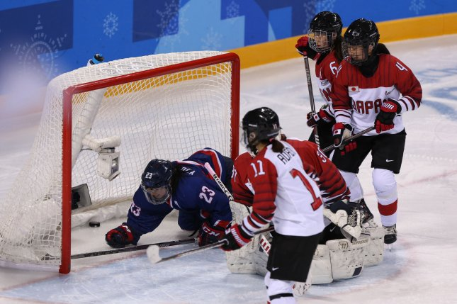 Park Yoonjung (23) of the joint North-South Korean hockey team falls in front of Japan's goal mouth as her teammate Randi Heesoo Griffin scores during their women's ice hockey preliminary round Group B game against Japan at the Kwandong Hockey Center in Gangneung, South Korea, on Wednesday. Photo by Andrew Wong/UPI