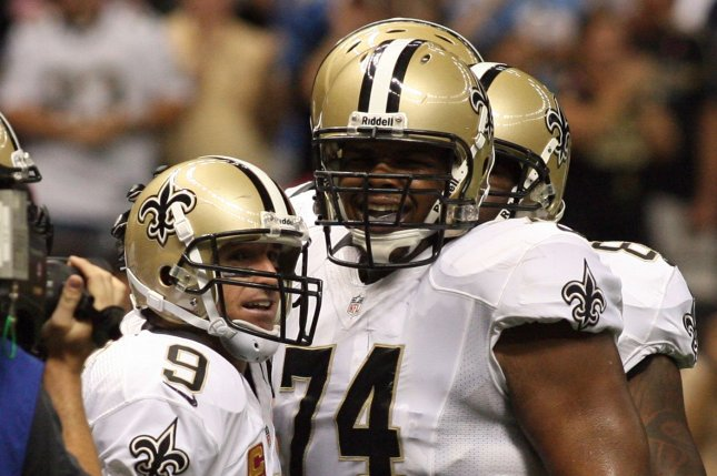 New Orleans Saints quarterback Drew Brees (9) celebrates with offensive tackle Jermon Bushrod (74) during the first quarter of the Saints' game against the then-San Diego Chargers on October 7, 2012 at the Mercedes-Benz Superdome in New Orleans, Louisiana. File photo by A.J. Sisco/UPI