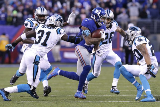 New York Giants star wide receiver Odell Beckham Jr. (13) is surrounded by Carolina Panthers defenders when he makes a 40-yard reception in the fourth quarter on December 20, 2015 at MetLife Stadium in East Rutherford, New Jersey. File photo by John Angelillo/UPI