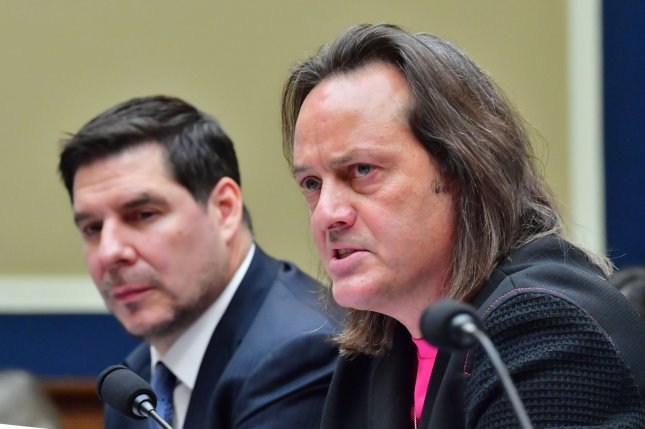 T-Mobile CEO John Legere, R, and Sprint Executive Chairman Marcelo Claure testify before a House Energy and Commerce Committee hearing on the proposed T-Mobile and Sprint merger, in Washington, D.C. Photo by Kevin Dietsch/UPI