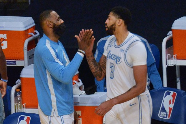 As part of its updated COVID-19 protocol, the NBA said players cannot arrive at arenas more than three hours before tip-off and must limit pre- and post-game interactions to elbow and fist bumps. File Photo by Jim Ruymen/UPI