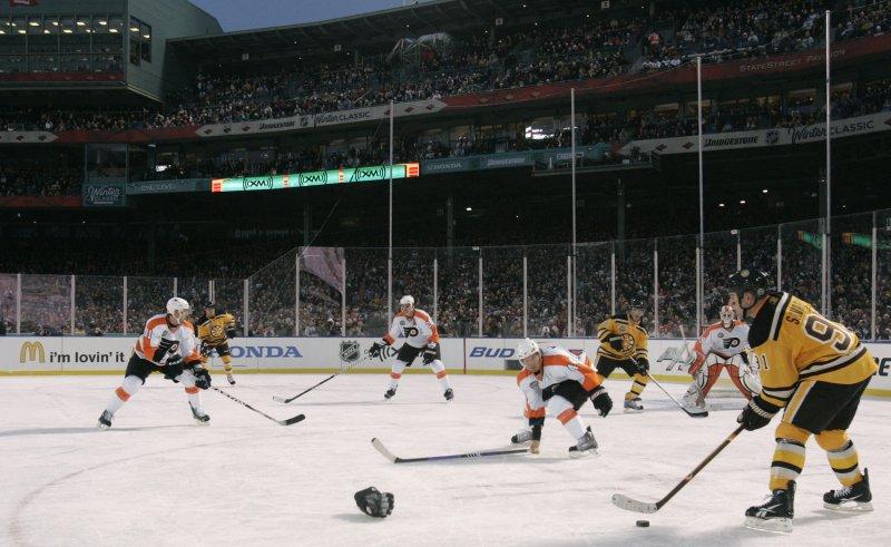 Marc Savard (91) looks to make a pass at the NHL Winter Classic against Philadelphia on Jan. 1, 2010. UPI Photo/Matthew Healey