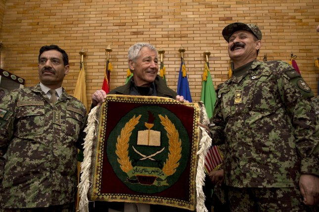 Secretary of Defense Chuck Hagel, seen here with Afghan Brigadier General Aminullah Patyani, Commander, Kabul Military Training Center, in Afghanistan, lauded the signing of a much delayed Bilateral Security Agreement with the U.S. and a Status of Forces Agreement with NATO. (UPI/Erin A. Kirk-Cuomo/DOD)