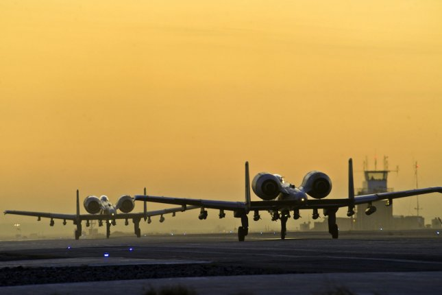 A pair of A-10C Thunderbolts from the 354th Expeditionary Fighter Squadron taxi down the runway at Kandahar Airfield, Afghanistan. UPI/Efren Lopez/U.S. Air Force