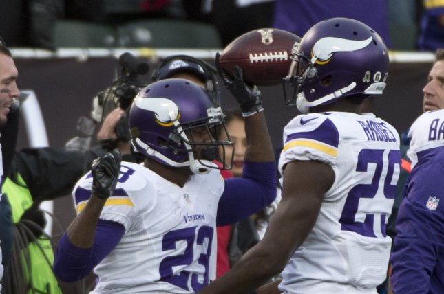 Minnesota Vikings Terrence Newman (23) is congratulated by Xavier Rhodes (29). Photo by Terry Schmitt/UPI