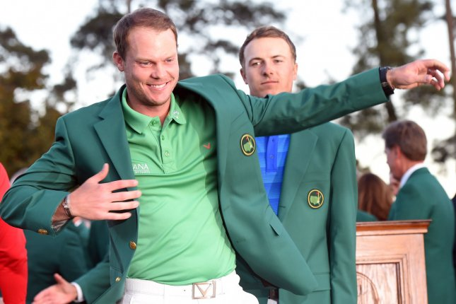 2015 champion Jordan Spieth puts the Green Jacket on Danny Willett of England after Willett wins the 2016 Masters Tournament with a score of 5 under par at Augusta National in Augusta, Georgia on April 10, 2016. Danny Willett won in his second Masters and he became the first player from England to win the green jacket since Nick Faldo in 1996. Photo by Kevin Dietsch/UPI