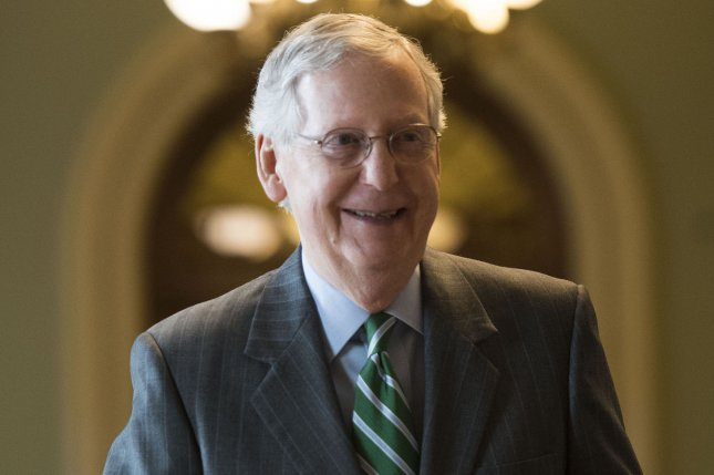 Senate Majority Leader Mitch McConnell, R-Ky., walks out of the Senate chambers after unveiling the Republican healthcare bill on June 22. But one week, later he delayed a procedure vote on the bill until after a Fourth of July recess because he didn't have enough support. On Tuesday, he announced the Senate will delay its August recess to deal with healthcare and other matters. Photo by Kevin Dietsch/UPI