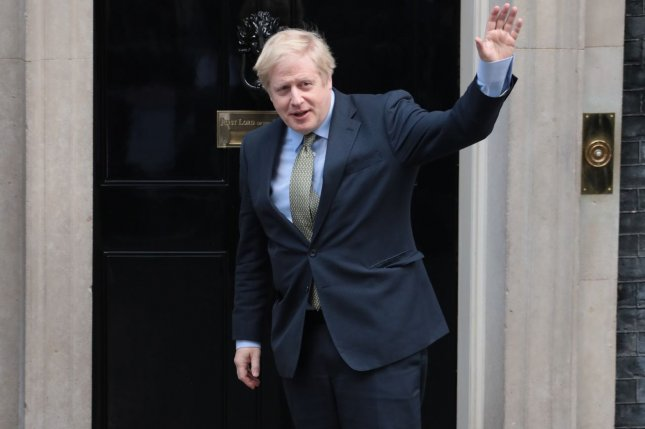 Newly re-elected British Prime Minister Boris Johnson waves to reporters Friday at No.10 Downing Street in London after visiting Queen Elizabeth II. Photo by Hugo Philpott/UPI