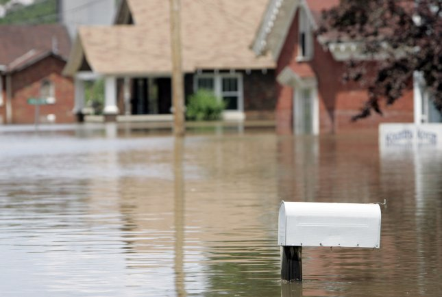 A mailbox pokes out of the water in downtown La Grange, Missouri, June 22, 2008. (UPI Photo/Mark Cowan)