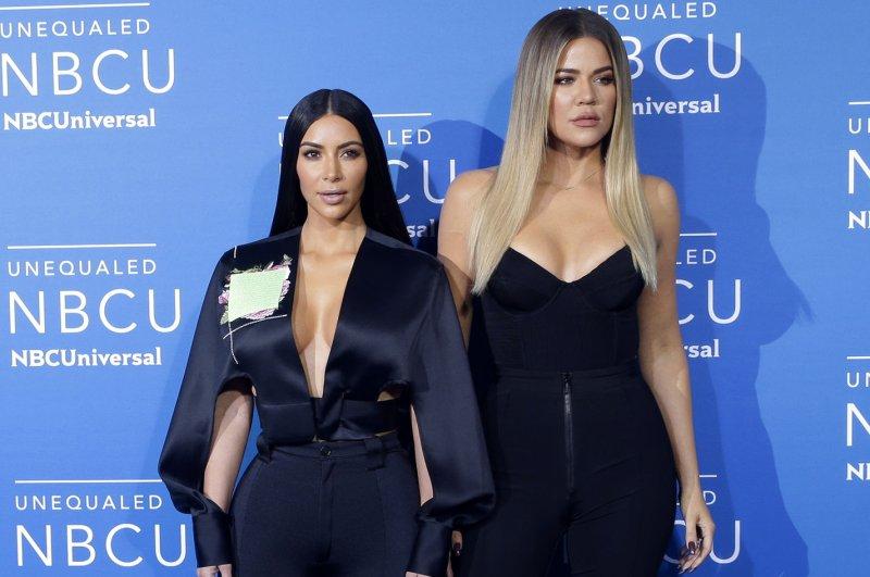 Kim and Khloe Kardashian have shared on social media their new family Christmas card. File Photo by John Angelillo/UPI