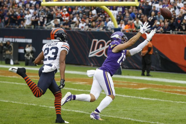 Minnesota Vikings quarterback overthrew wide receiver Adam Thielen (R) with a deep pass in the first half of a loss to the Chicago Bears Sunday at Soldier Field in Chicago. Photo by Kamil Krzaczynski/UPI